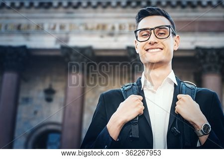 Business and vacation. Portrait of a happy goodlooking business man traveling the world. Business trip.