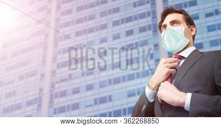 Masked business man, coronavirus pandemic affecting businesses concept
