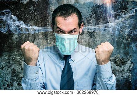 Portrait of a furious businessman, coronavirus and bad mood concept