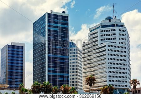 Modern office buildings lined with glass in business center of Tel Aviv, Israel.
