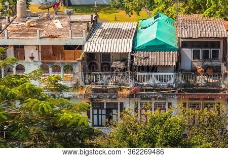 Poor Houses In Big City. Messy Architecture In A Poor Street Of Bangkok, Thailand.