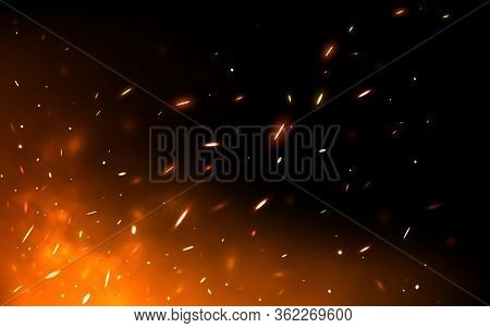 Fire Sparks On Dark Backdrop. Glowing Particles Flying Up. Realistic Fire And Flame. Yellow And Red