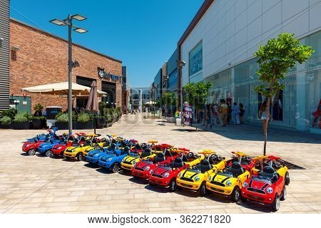 ASHDOD, ISRAEL - JULY 24, 2015: Shops, boutiques and stores in open air mall - owned by BIG Shopping Centers Ltd., founded in 1994 operates in 4 countries - Israel, the United States, India and Serbia