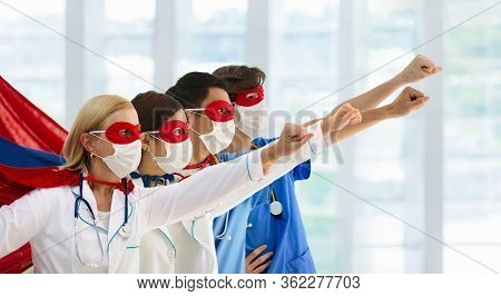 International Doctor And Nurse Team Wearing Surgical Face Mask In Superhero Cape. Medical Staff Duri