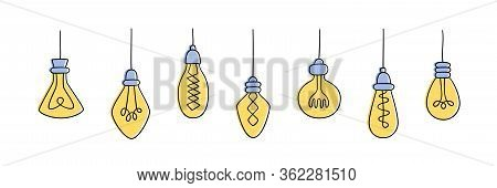 Set Of Hand Drawn Light Bulbs. Collection Of Different Yellow Loft Lamps In Doodle Style. Isolated V