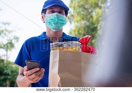 The Delivery Man Wears A Mask To Prevent The Spread Of Germs And Send The Goods Or Food That The Buy