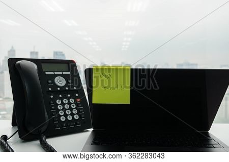 Notepad Of Check E-mail Reminder On The Notebook Computer Screen With Ip Phone In Office