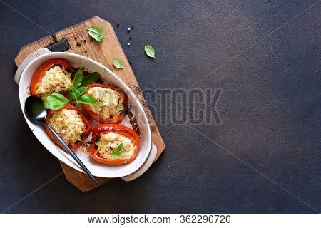 Baked Bell Pepper With Meat And Rice On A Concrete Dark Background.