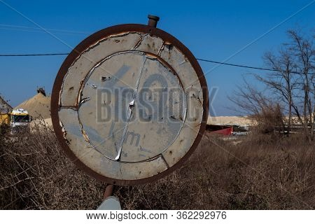 Old Weathered And Rusted Traffic Sign With A Speed Limitation Forty Km Per Hour. Nature With Trees A