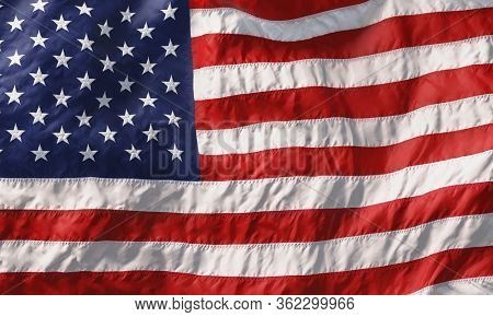 Background made of American flag waving in the wind. 3D rendering