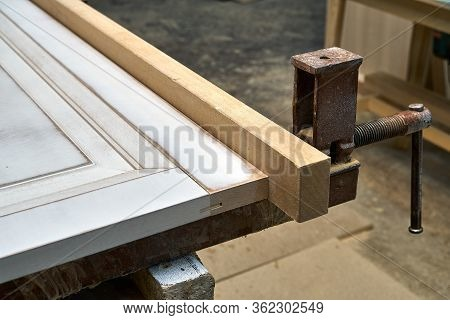 Mdf Cabinet Door. Joinery. Gluing And Clamping Mdf Cabinet Door In Workshop. Furniture Manufacture