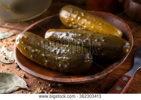 Delicious Naturally Fermented Kosher Dill Pickles On A Rustic Table Top.