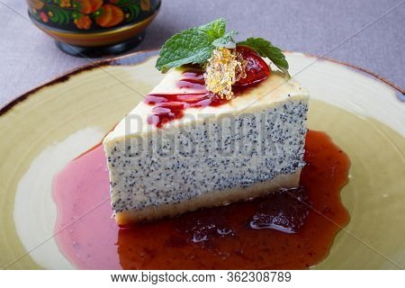 Cheese Cake With Poppy Seeds Decorated With Mint Leaf