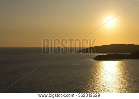 Colorful Ocean Sunset With The Setting Sun. Seascape At Sunset