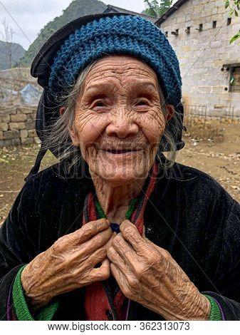Cao Bang, Vietnam, January 28, 2020 - 98 years old wrinkled vietnamese woman looking at camera, Cao Bang Province, Trung Khanh District