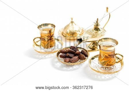 Tea Glasses With Dates On White Background. Oriental Hospitality