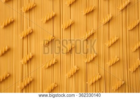 Background Of Long And Short-cut Dry Pasta, Spaghetti And Spiral