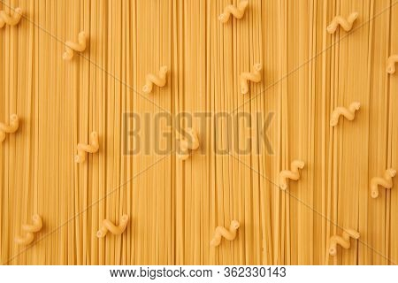 Background Of Long And Short-cut Dry Pasta, Spaghetti And Corkscrews