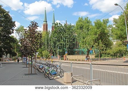 Warsaw / Poland. 27 July 2019: View Of City Street With Many Bicycles. Bicycles Parked In Rental Par