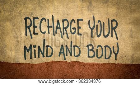 recharge your mind and body advice - inspiraitonal handwriting on a handmade bark paper, well being, dealing with stress and fatgue, mental health and personal development concept