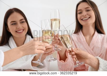 Beautiful Young Ladies Clinking Glasses Of Champagne At Pamper Party, Focus On Hands. Women's Day