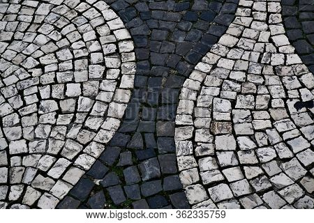 Image With Fragment Of Typical Decorative Portuguese Cobblestone Handmade Pavement In Portugal.