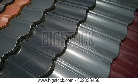 Close-up Of Several Rows Of Plastic Roofing Of Various Colors In Shape Of Tiles,taken Diagonally,cov