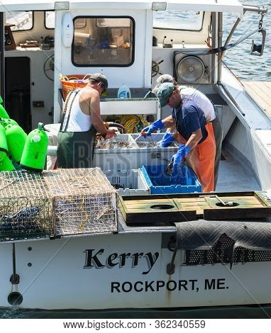 Rockport, Maine, Usa - 4 August 2017: Three Fishermen On Their Fishing Boat Sorting The Days Catch O