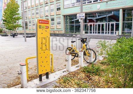 Bratislava (slovakia) - October 06 2019: Yellow Public Bikes Locked In Docking Station In Front Facu