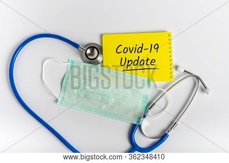 Stethoscope, Face Mask With Words Covid-19 Update On White Background. Coronavirus Concept And Quara