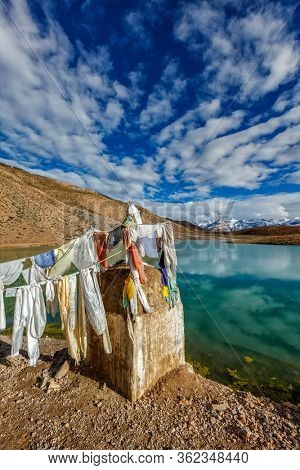 Small gompa with buddhist prayer flags at sacred Dhankar Lake in Himalayas. Spiti Valley, Himachal Pradesh, India