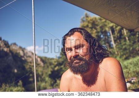 Portrait Of A Bearded Male Tourist On A Halt