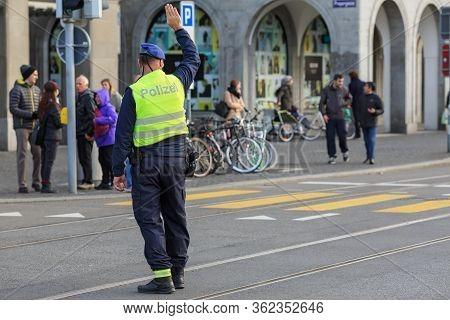Zuerich, Switzerland - November 9, 2019. Swiss Police Officer Blocking Traffic On A City Street For