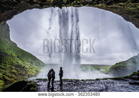 South Region, Iceland - June 9, 2018: Tourist On Seljalandsfoss Waterfall On Seljalands River That H