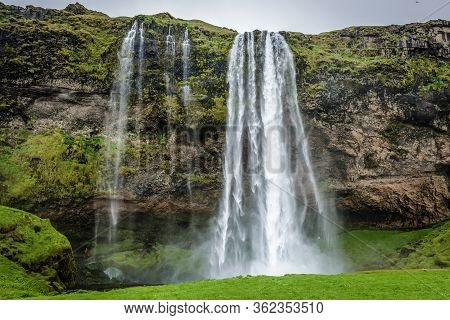 South Region, Iceland - June 9, 2018: Seljalandsfoss Waterfall, Part Of Seljalands River That Has It