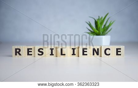 Resilience Word Concept On Cubes On Blue Background.