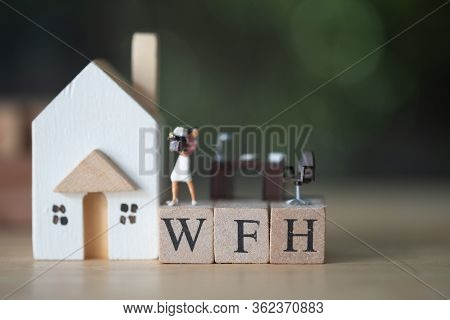 Miniature People Work Stand On Wood Block Of Wfh. Concept Image Wfh (work From Home). During The Cor