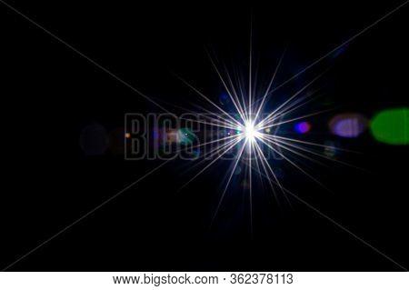 Lense Flare Sunlight Ray. Sun Shine Flash Effect Or Star Spot Glow Light On Black Background. Gleams