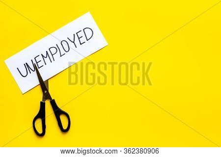 Unemployed - Employed - Torn Paper Sheet, Sciccors On Yellow Background Top View Space For Text. Hir