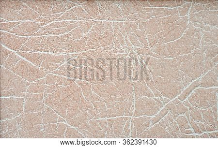 Genuine White Leather With Folds Artificially Tinted With Beige. Background, Texture.