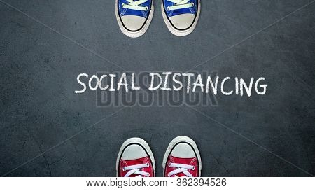Social Distancing. Two People Keep Spaced Between Each Other For Social Distance, Increasing The Phy