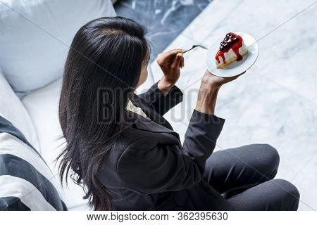 Happy Woman Eat Cake Delicious Sweet Dessert In Chocolate Cafe. Asian Woman Holding Fork Eating Swee