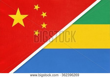 China Or Prc Vs Gabon National Flag From Textile. Relationship Between Asian And African Countries.
