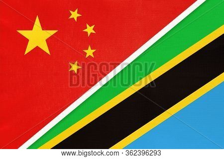 China Or Prc Vs Tanzania National Flag From Textile. Relationship Between Asian And African Countrie
