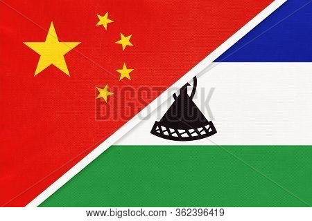 China Or Prc Vs Kingdom Of Lesotho National Flag From Textile. Relationship Between Asian And Africa