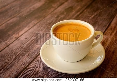 Hot Coffee Americano On The Old Wooden Table. A Cup Of Coffee On A Plate.  Americano Black Coffee. C