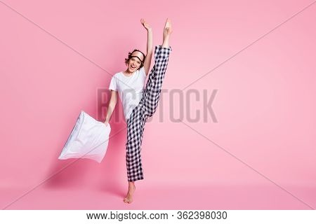 Full Body Photo Of Funny Lady Hold Pillow Raise Leg Slumber Night Demonstrate Exciting Agility Wear
