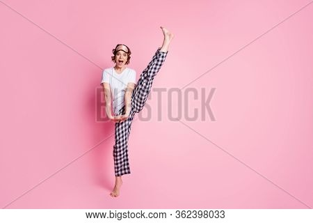 Full Body Photo Of Funny Lady Raise Leg High Slumber Night Party Presenting Perfect Exciting Agility