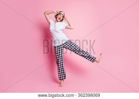 Full Body Photo Of Funny Lady Raise Leg Good Mood Slumber Night Party Look Side Empty Space Wear Sle