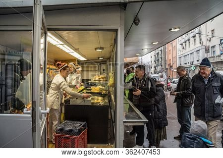 Belgrade, Serbia - December 7, 2017: Bakery In A Market Of Vracar District With Clients Rushing Whil